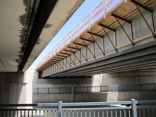 Photo of underside of Broadway commuter rail bridge