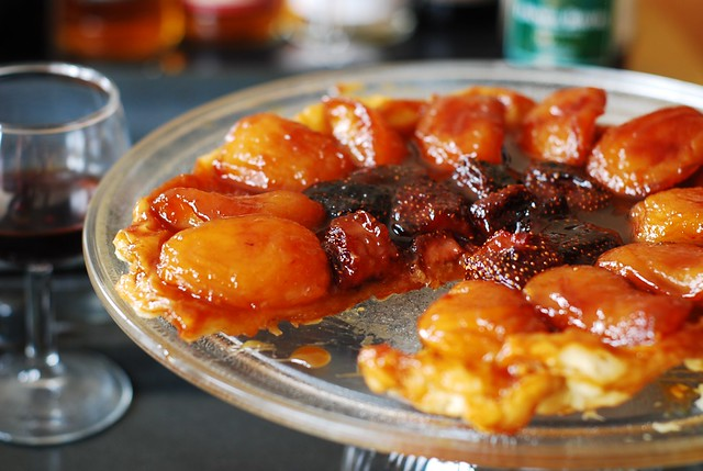 Apple tarte tatin, or caramel apple tart, with strawberries