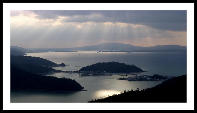 A FINE CURTAIN OF LATE-AFTERNOON SUNBEAMS OVER SHIOYA BAY in NORTHERN OKINAWA