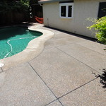 Plum Creek Exposed Aggregate Patio Added To Pool Deck