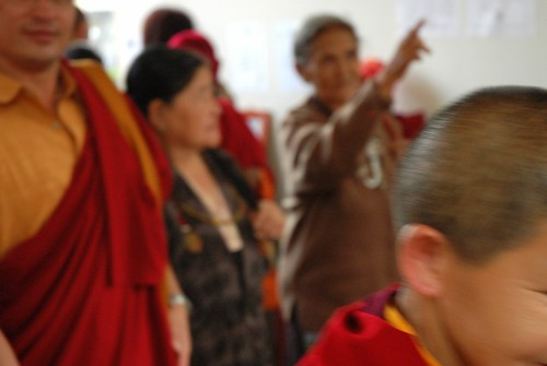 Tibetans, monk, laypeople, pointing out, malas, nun, departing Sakya Lamdre, Tharlam Monastery, Boudha, Kathmandu, Nepal by Wonderlane