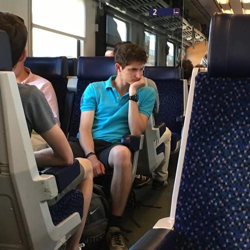 Contemplative lad, train to Salzburg departing Villach, Austria
