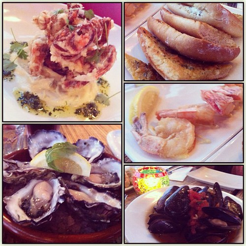 Seafood Tapas delights: Soft Shell Crab, Oysters, Crispy Tiger Prawns, Mussels + Garlic Bread.