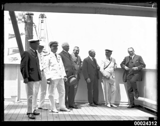 Group portrait with eight men on board RMS ORSOVA, including Stanley Bruce and Lord Stonehaven