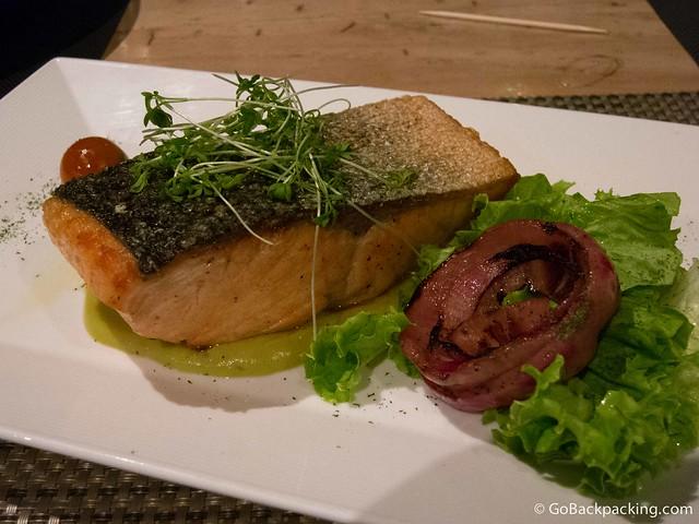 Giant salmon filet with microgreens and salad