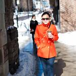 orange peacoat and jeans