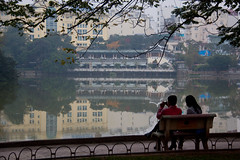 Couple on a Bench at Hoan Kiem Lake - Hanoi, Vietnam