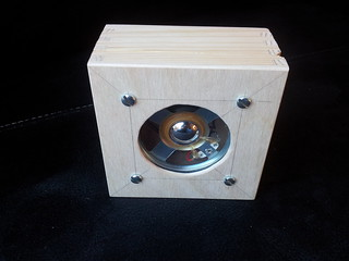 Speaker fitted to lid of box