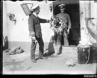 Officer with wreath on HMAS AUSTRALIA I
