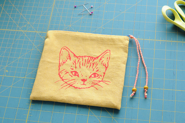 yellow zippered kitty pouch