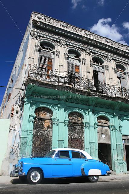 Classic American Car And Hispanic Architecture In Cuba