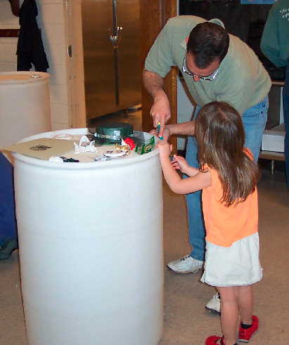 Image of people installing a rain barrel.
