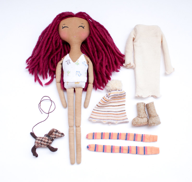 red doll and her stuff
