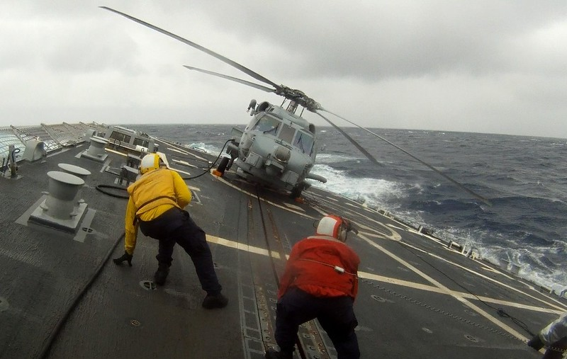 South China Sea - Lone Wolf 716 prepares for flight in heavy seas.