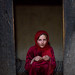 Portrait of an afghan girl with pale skin wearing red clothes, Badakhshan province, Khandood, Afghanistan by Eric Lafforgue