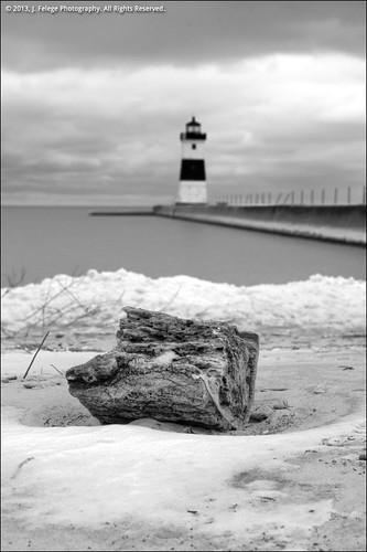 winter light blackandwhite bw lighthouse white snow black monochrome blackwhite pennsylvania erie peninsula beacon presqueisle northpierlight presqueislestatepark eriepennsylvania tamronspaf2875mmf28xrdildasphericalif northwestpennsylvania waternavigation eriepeninsula northpierlighterie
