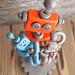 Commission: Robot Dad holding children robots