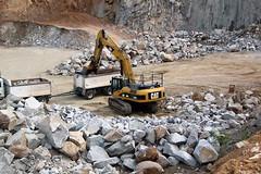 asphalt(0.0), demolition(0.0), track(0.0), waste(0.0), rubble(1.0), vehicle(1.0), mining(1.0), construction equipment(1.0), bulldozer(1.0), rock(1.0), quarry(1.0),