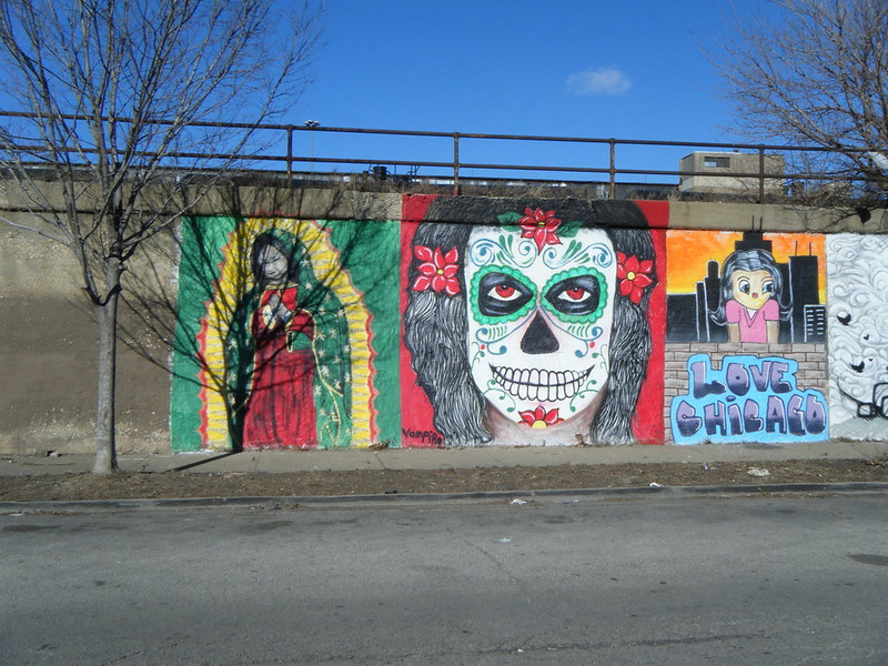 Praying figure, vampire, and Love Chicago murals