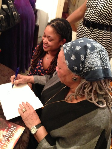 Toni Morrison signing a book