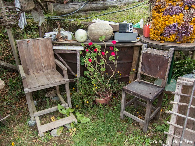 Wooden chairs like the one on the left were used to carry the sick from Santa Elena to Medellin for treatment
