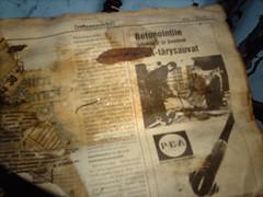 Old newspaper in an abandoned wooden villa in Kruunuvuori
