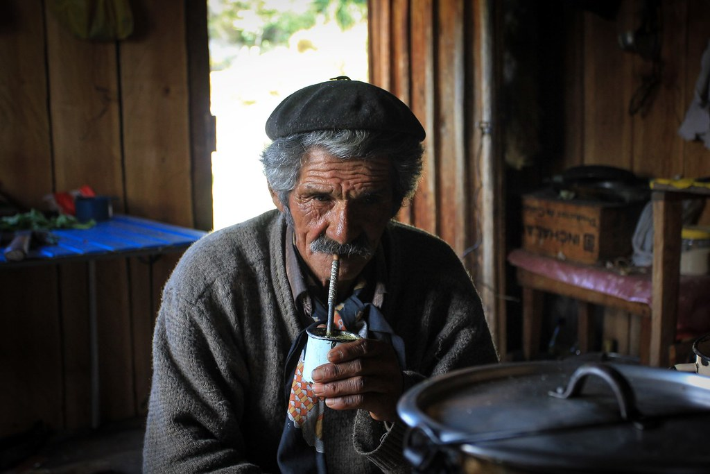 Don Rial Heraldo. Patagonian gaucho, living in a far-off radar valley, deep in the Andean mountains, a 4-day horseback ride to the nearest town of Cohrane. We sip yerba mate all afternoon and can't stop laughing with all his stories and jokes he fires at us while a storm approaches outside. Aysen, Patagonia, Chile.