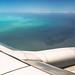 Caribe - flying - blue sea - cellularphone