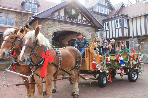 a horse-drawn hayride in front of the Mansion for Christmas at Cabrini