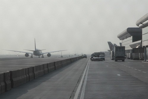 Passing taxiing jets on the western side of Doha International Airport