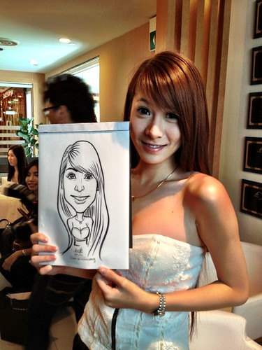 caricature live sketching for Orchard Scotts Dental for Miss Universe Singapore - 1
