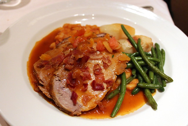 Hawaiian Luau Pork with Apricot Drippings served with a white bean and smoked bacon ragout, roast potatoes