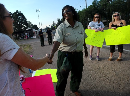 Jerri Marr, forest supervisor for the U.S. Forest Service, greets the crowd that gathered to thank the firefighters returning and leaving the fire camp Tuesday morning, July 3, 2012,  at Holmes Middle School in Colorado Springs, Colo. The Waldo Canyon Fire is now 70 percent contained.  (The Gazette, Christian Murdock)