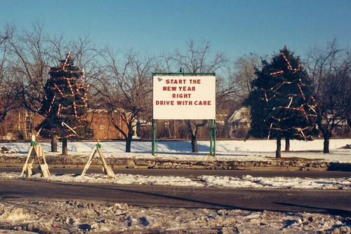 The twin evergreen trees along the east side of South Kedzie Avenue near West 93rd Street. (Gone.)  Evergreen Park Illinois.  Early January 1988. by Eddie from Chicago
