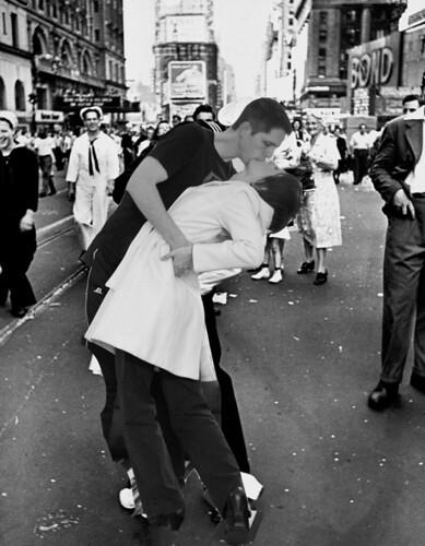 A jubilant American sailor clutching a w