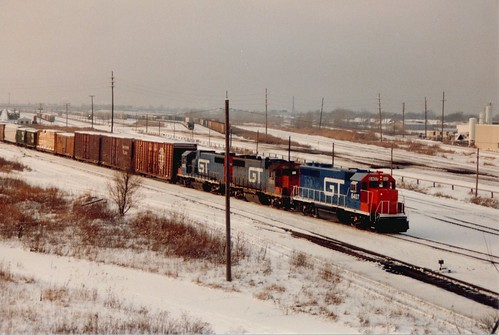 Eastbound Grand Trunk Western Railroad freight train waiting to depart from the Belt Railway of Chicago's Clearing Yard.  Chicago Illinois.  January 1987. by Eddie from Chicago