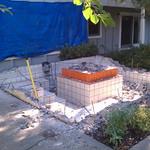 Backyard concrete fountain demolition and removal.