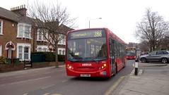London bus arrives by Julie70