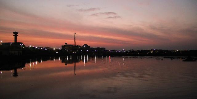 Sun sets over the Cooum