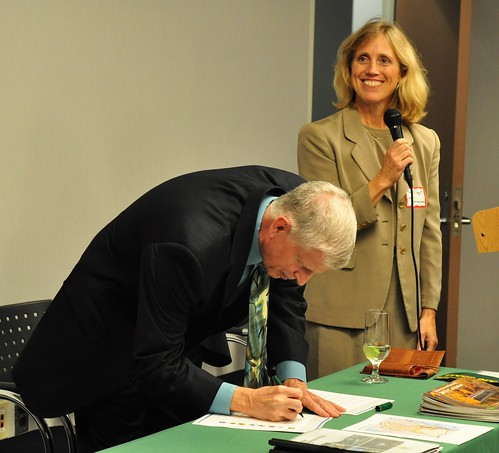U.S. Forest Service Chief Tom Tidwell signs the forest restoration strategy as Sally Claggett, Forest Service Chesapeake Liaison, looks on. (Forest Service photo by Bob Lueckel)