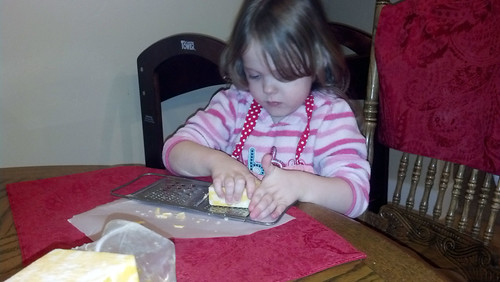 Helping to grate cheese