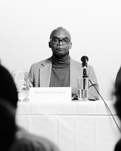 "Dr. Darrell Moore as Michel Foucault live in Mary Patten's ""PANEL"" @ threewalls"