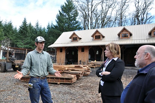 Ben Deumling (left) explains Zena Forest Products' land management, harvest, and milling operations to USDA's Lillian Salerno (center) and Martin Zone.