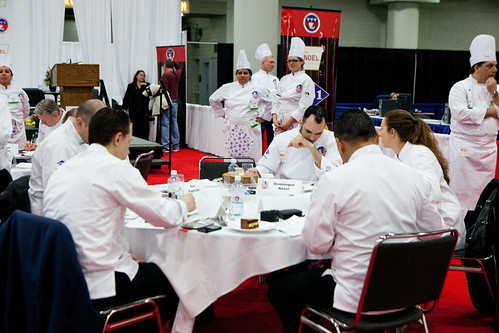 Cake judging table with Chef Dominique Ansel (sitting, off center right) and Michael Laiskonis (off-center left)
