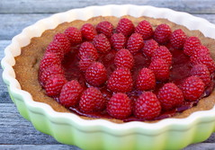 strawberries(0.0), strawberry pie(0.0), strawberry(0.0), plant(0.0), produce(0.0), pastry(1.0), berry(1.0), baked goods(1.0), frutti di bosco(1.0), tart(1.0), fruit(1.0), food(1.0), dish(1.0), dessert(1.0), raspberry(1.0),