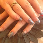 Full set of acrylic nails with glitter gel polish on tips ,ring finger full