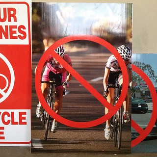 Crazy anti- #bikela signs at Colorado bike lane meeting.