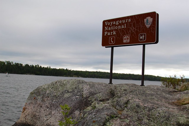 Voyageurs sign standing on the rock