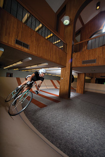 "Sam Starr '10 on his bicycle on the indoor velodrome that he built as his senior art project (titled ""Circulus"") inside the decommissioned Mudd Science Library."