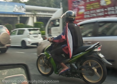 motorcyclist wearing jacket backwards R0021344 copy